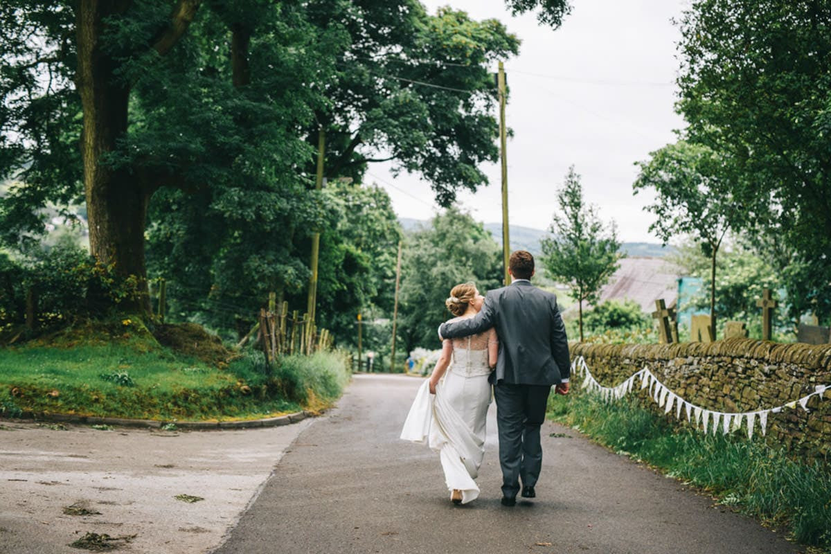 village hall wedding in cheshire - walking hand in hand
