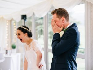 natural wedding photography - bride laughs during speech
