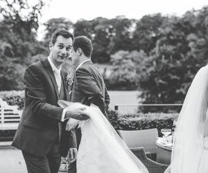 documentary wedding photography lancashire - groom carries the dress