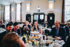 guests laugh during speeches - documentary wedding photography