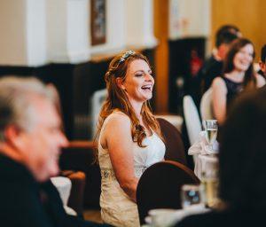 bride laughs during speeches - village hall wedding