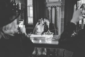kissing whilst signing the register