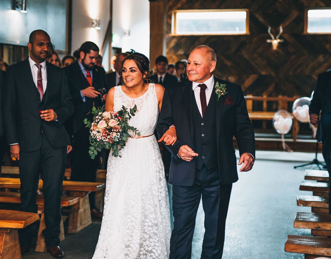 walking down the aisle - humanist ceremony at Owen House wedding barn