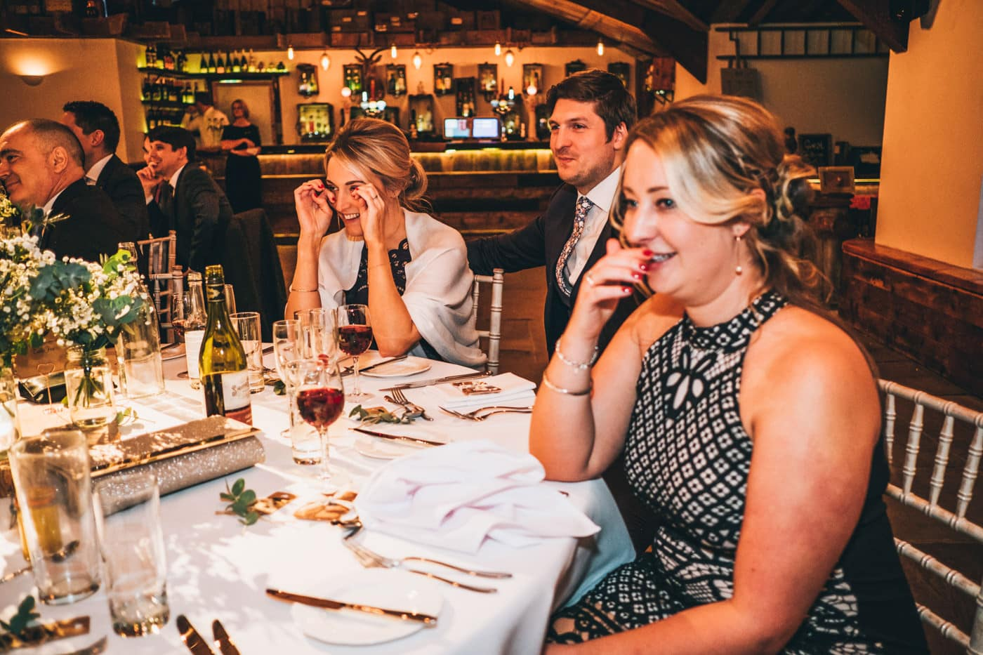guests laughing and crying - documentary wedding photography cheshire