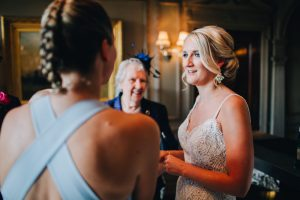 bridesmaid and guests chatting