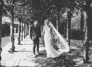 bride and groom walk through the grounds at Thornton Manor
