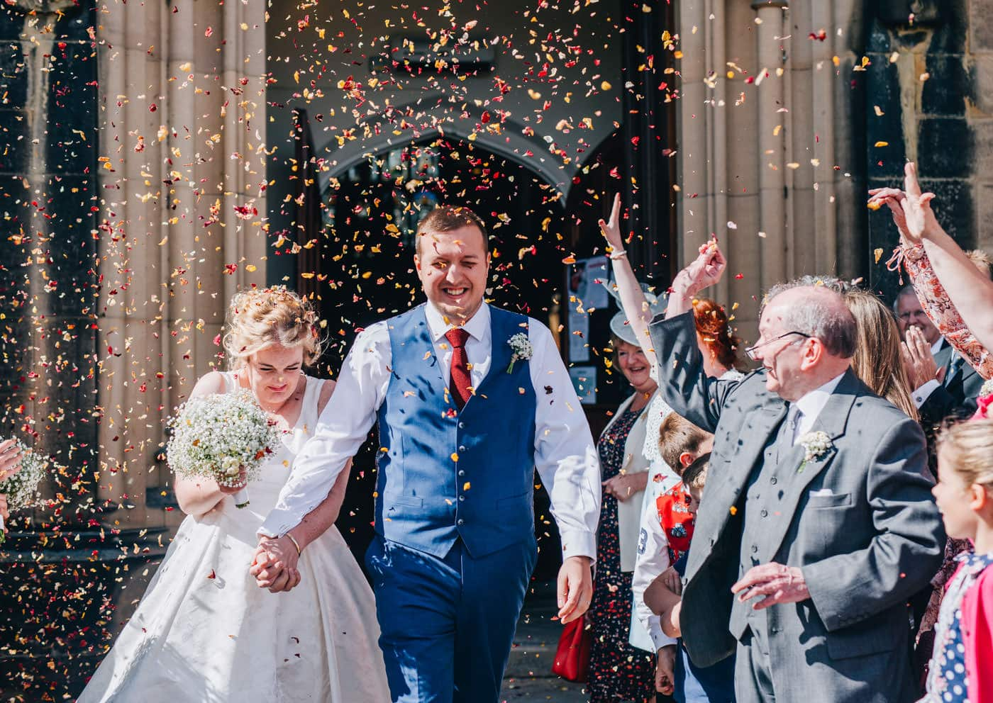 fun wedding pictures - bride and groom confetti