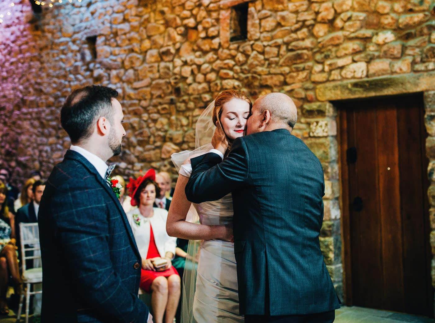 dad kisses bride - emotional wedding moments