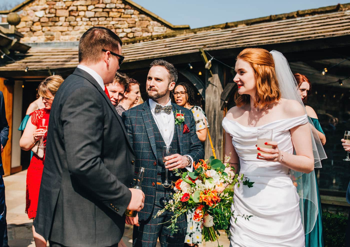 bride and groom chat to guests - documentary wedding photographer lancashire
