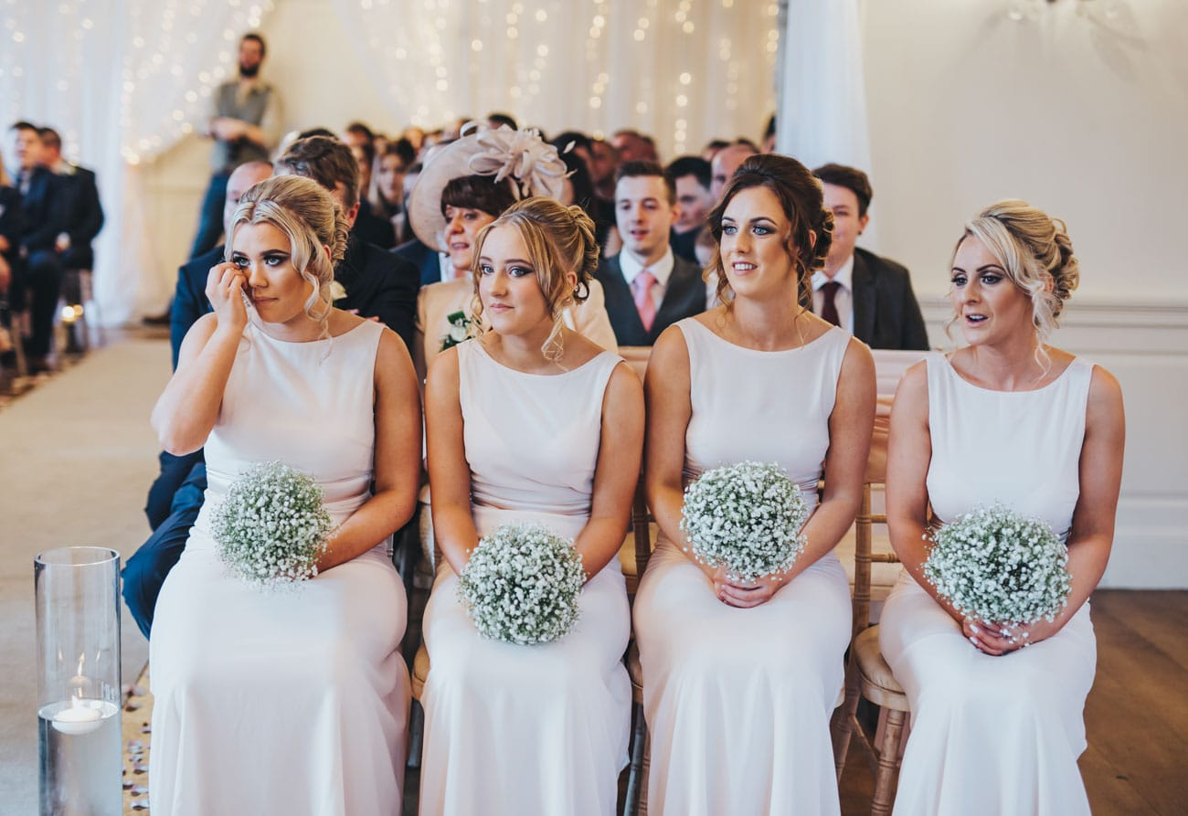 Emotional pictures of bridesmaids at Eaves Hall