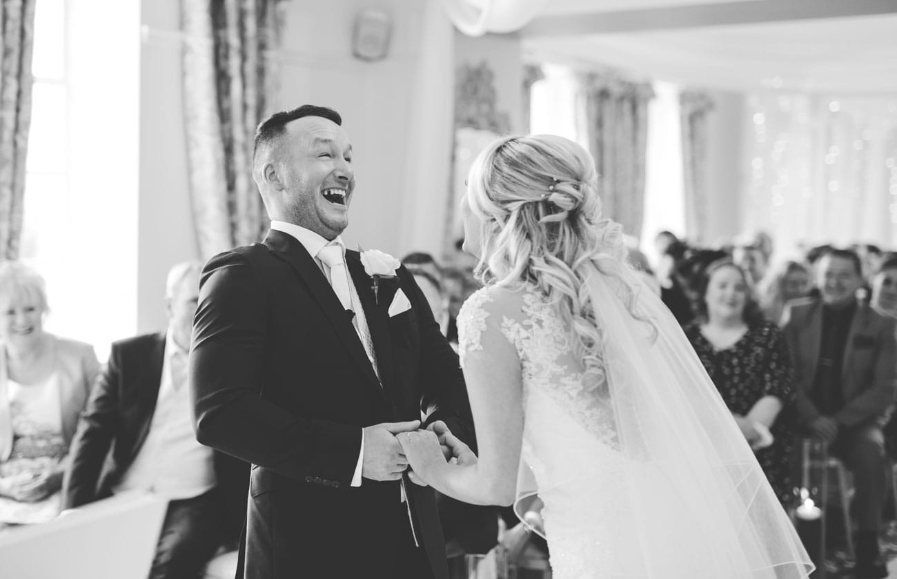 laughter during the wedding ceremony - Eaves Hall Wedding Photography