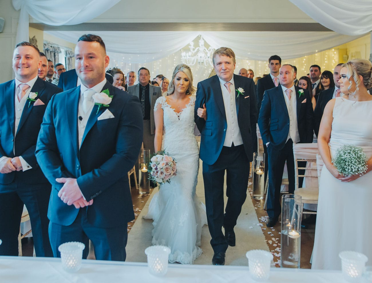 walking down the aisle at Eaves Hall