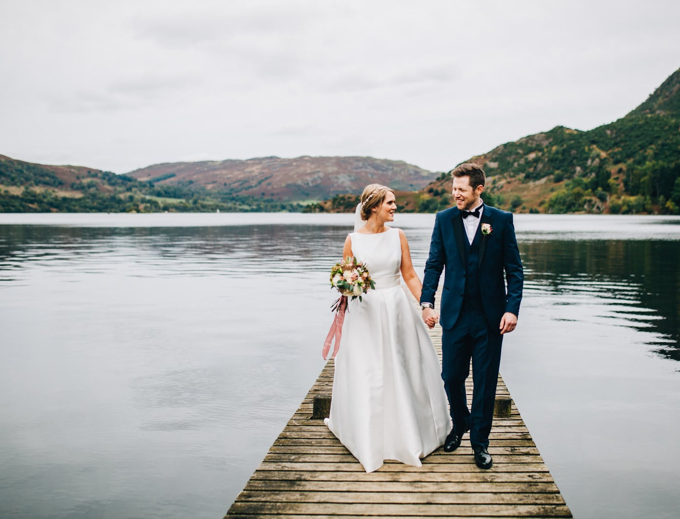 walking on the jetty - inn on the lake wedding